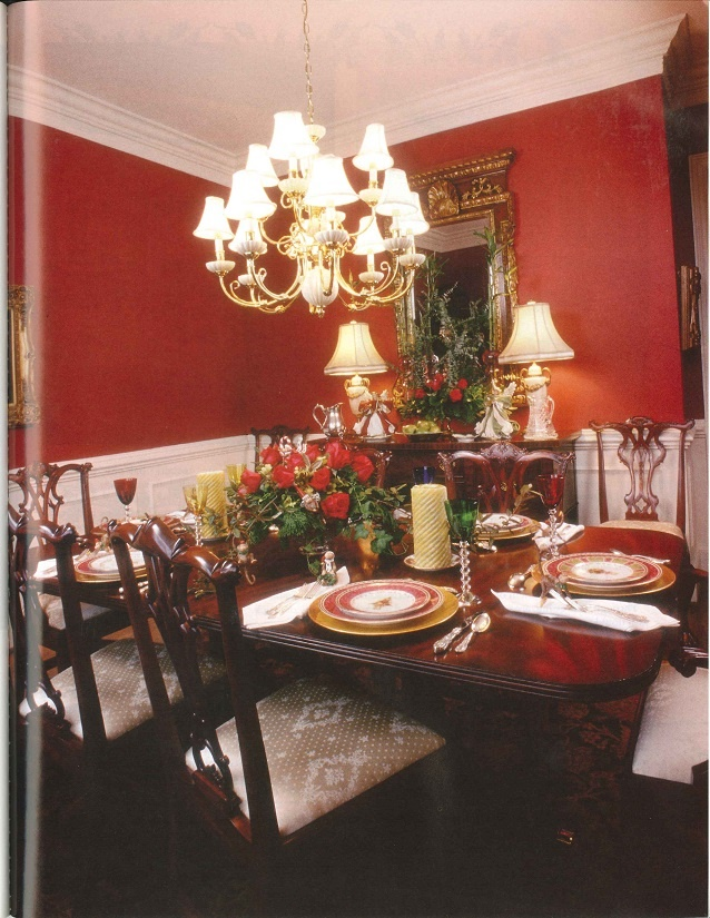 Rich Deep Red Walls Framed With White Wainscoting And Moulding Complement The Maitland Smith Mahogany Table Chairs Sideboard A Theodore Alexander